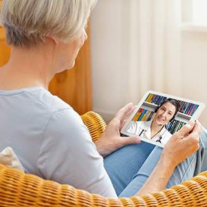 Family Practice Associates patient talking to a doctor via TeleHealth